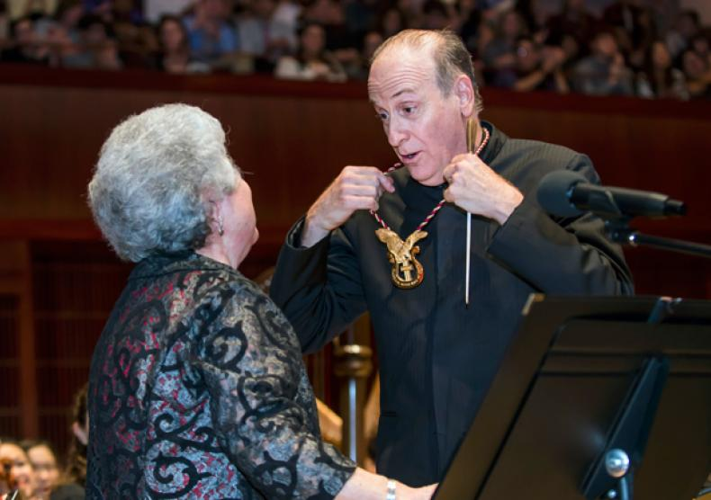 Larry Rachleff, Rice's Walter Kris Hubert Professor of Orchestral Conducting and ACMHF inductee, was recognized at the Oct. 5 orchestra concert by Marie Speziale, a board member for the ACMHF and a Rice professor emerita of trumpet. Photo by Tommy LaVergne.