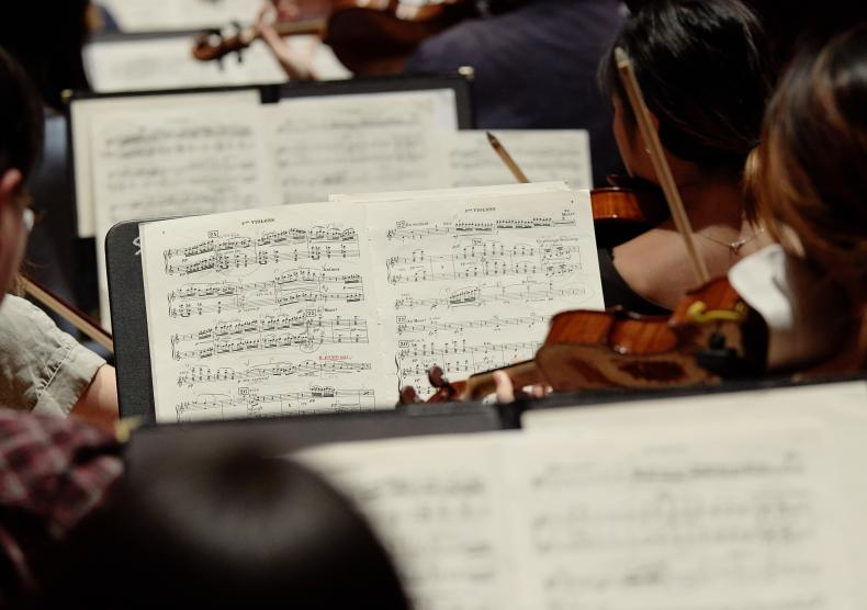 Shepherd School Symphony Orchestra violin section during rehearsal