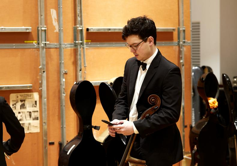 Cellist backstage before an orchestra performance