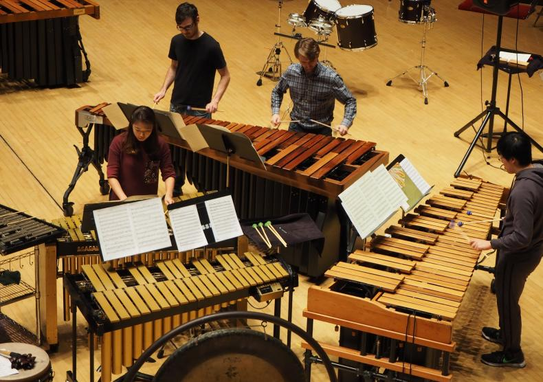 Students during Percussion Ensemble dress rehearsal on Stude Concert Stage